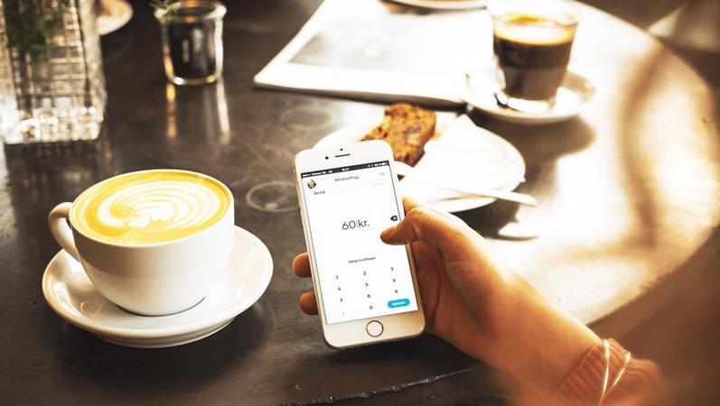 Billede, der viser en overførsel i MobilePay på en café.